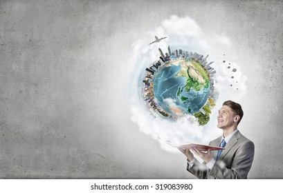 Young businessman with opened book in hands. Elements of this image are furnished by NASA