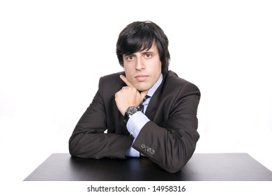 Young Businessman over a desk, full of thoughts, isolated in white background