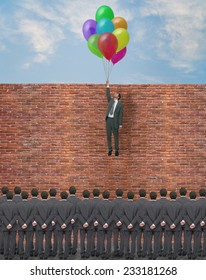 young businessman overcomes an obstacle for the consideration of the crowd
