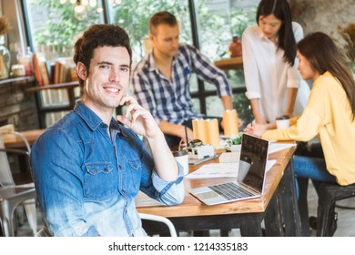 Young businessman and partner meeting and discuss in coffee shop