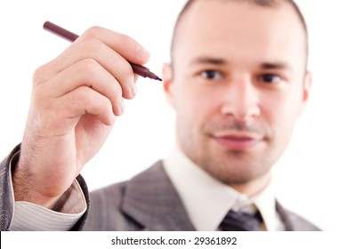 Young businessman with pen - the hand is in focus