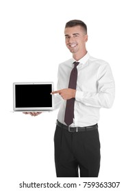 Young businessman pointing at laptop screen against white background