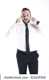 Young businessman pointing on eyes, on white background