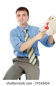Young businessman pointing on toy with number one. Isolated on white