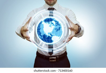 Young businessman presenting new technologies in his virtual office. Futuristic background. Modern business concept. Copy space for your text and logo.