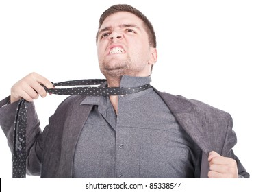 young businessman pulling his tie and getting stressed