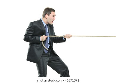 A young businessman pulling a rope isolated on white background