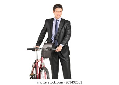 Young businessman pushing a bike isolated on white background