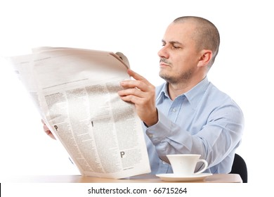 Young businessman reading newspaper isolated on white background