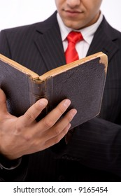 young businessman reading an old law book, shallow dof
