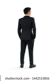 Young businessman rear view, full length portrait isolated on white background.