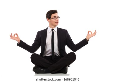 Young businessman relaxing. Full length studio shot isolated on white.