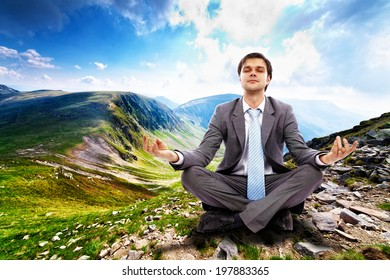 Young businessman relaxing in the mountains, away from the city life and business meetings