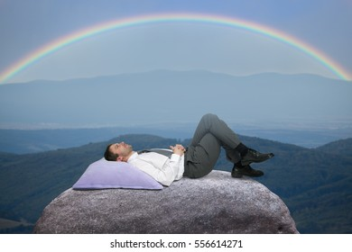 Young businessman resting after work in the countryside