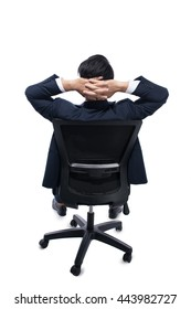 Young businessman resting on armchair with his hands behind his head