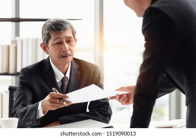 The young businessman sending the report to his boss on hand in the office room.