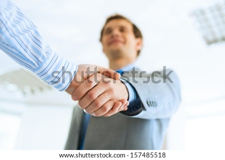 young businessman shaking hands with a colleague, an agreement