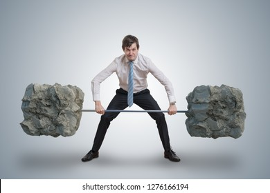 Young businessman in shirt is lifting heavy weights.