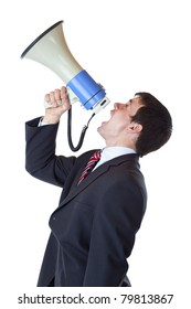 Young businessman shouts loudly into megaphone overhead.Isolated on white background.