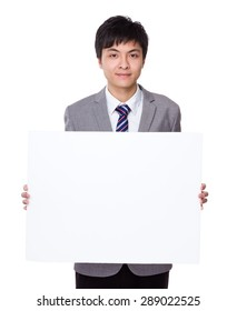 Young businessman show with white board