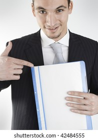 young businessman showing folder that can be the data of a salesman, or businessman showing a contract, etc. (the file can be filled as desired)
