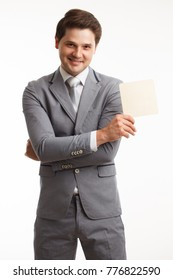 Young businessman showing signboard, isolated on white