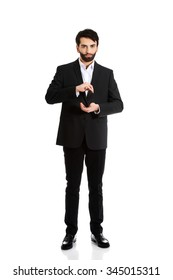 Young businessman showing the size in hands.