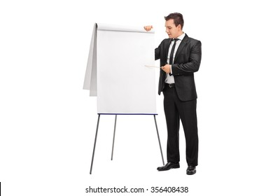 Young businessman showing something with a stick on a presentation board isolated on white background