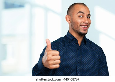 Young Businessman Showing Thumb Up