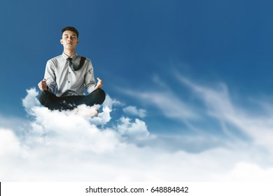 Young Businessman Siting on Cloud above the sky with Yoga meditation posture to find solution or wisdom, Supernatural photography
