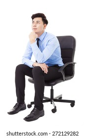 Young businessman sitting in a chair and thinking