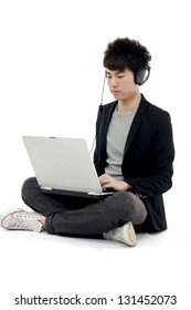 Young businessman sitting floor with headphones and laptop on help center