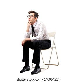 young businessman sitting on a chair thinking