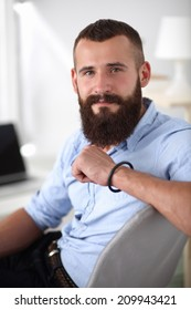 Young businessman sitting on chair in office