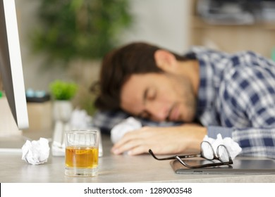 young businessman sleeping after drinking from stress