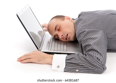 young businessman sleeping on laptop