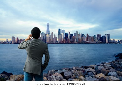 Young businessman with smartphone outdoor