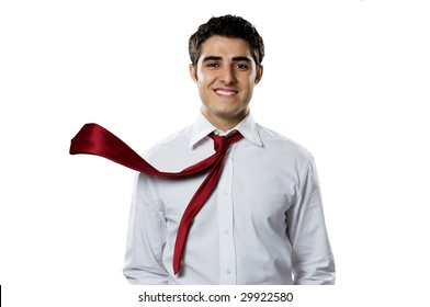 Young businessman smiling at camera with blowing necktie. Good business in action!