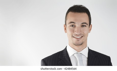 young businessman smiling with confidence.