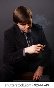 young businessman smoking a cigar