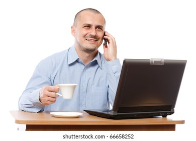 Young businessman speaking on mobile phone and drinking coffee