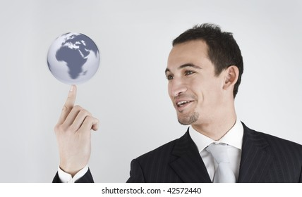 young businessman spinning (holding) the world (globe) in his finger