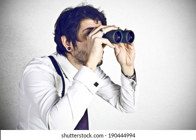 Young businessman spying