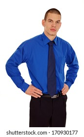 Young businessman standing at blue shirt and tie