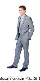 Young businessman standing with hands in pockets isolated on a white background