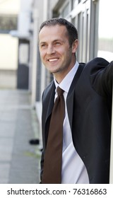 Young businessman standing outside