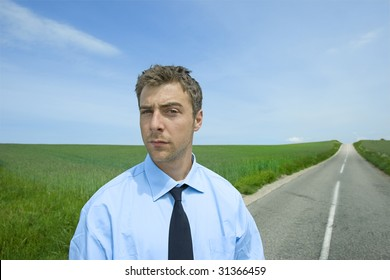 young businessman is standing at the road ahead