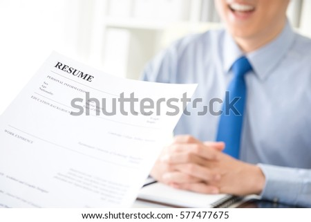 young businessman submitting resume employer review stock photo
