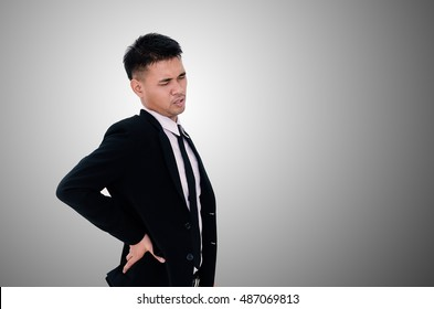 Young businessman suffering from back pain