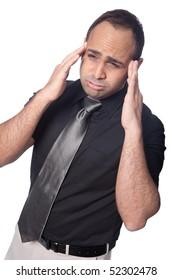 Young businessman suffers stress headache.